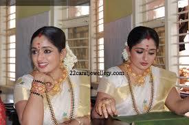 kavya madhavan wedding jewellery south indian traditional