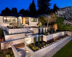 wide luxury house design with exterior stone for luxury fences and