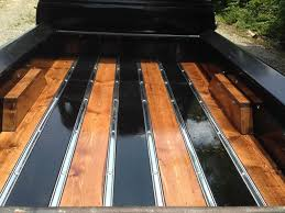 wooden truck bed alternating wood stain colors on wood bed floor panels with wooden