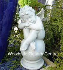 polystone sleeping cherub on home or garden ornament
