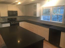 granite countertop pictures of cream colored kitchen cabinets