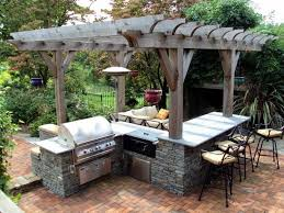 rustic wooden pergola with stone cabinet and chic ceramic wall