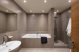 apartments main bathroom with light brown with ceramics tiling
