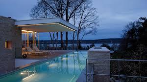 modern house with infinity pool near lake starnberg germany