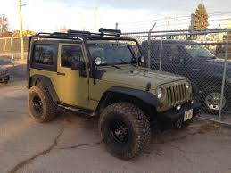 orange jeep wrangler with black rims barricade wrangler roof rack textured black j100174 07 17