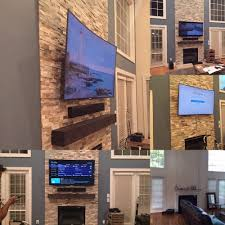 curved tv mounted over fireplace tv sound bar and mantle was