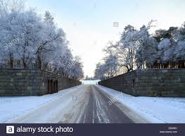 winter view of entrance to woodland cemetery in stockholm sweden