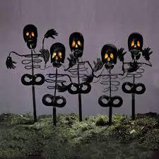 set of 5 black spooky skeleton lawn yard stakes orange