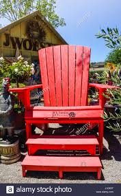 Chair In Garden Adirondack Chair In Garden Stock Photos U0026 Adirondack Chair In