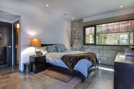 modern master bedroom with travertine tile floors zillow digs