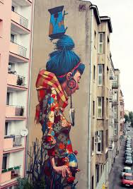 etam cru brightens city walls with epic colorful street art murals