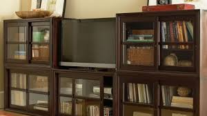awesome living rooms media cabinet with glass doors in aged