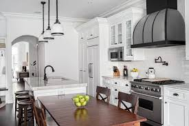 black and white kitchen framed pictures timeless traditional kitchen with white tile backsplash