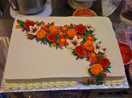 buttercream flowers sheet cake on the tiered cake cake designz