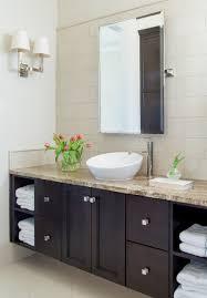 elegant bathroom dark cabinets crema marfil marble tiles