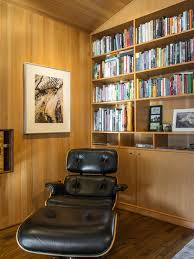 captivating home library design with brown wooden wall bookshelves