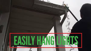 How To Put Christmas Lights On Tree by Easily Hang Christmas Lights Without A Ladder Youtube