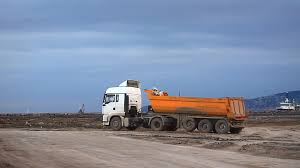 heavy duty dump truck works for formation of new land by filling