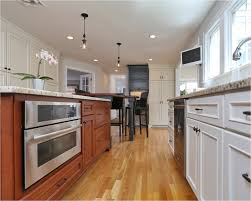 honey oak kitchen cabinets with wood floors what color laminate flooring with oak cabinets laminate