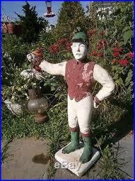 vintage antique lawn jockey with lantern cement