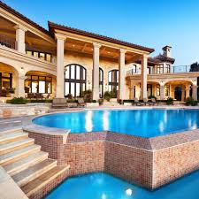 amazing mansions massive stone mansion with an infinity pool that flows into