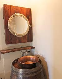 Rustic Bathroom Medicine Cabinets by Barrel Vanity And Porthole Medicine Cabinet