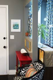 fascinating entryway paint color with slim red table under tiny