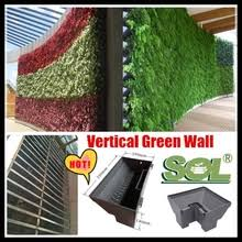 living wall vertical garden green wall grass flower vegetable