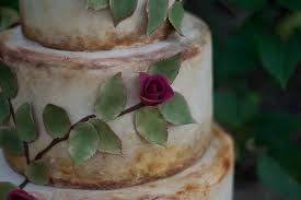 wedding cake with cascading leaves roses