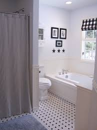 bathroom popular white design idea with bathtub black floor tile