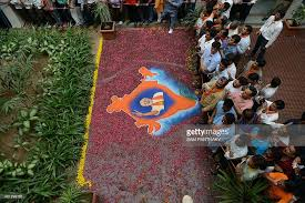 rangoli decoration bjp supporters look on near a rangoli decoration showing a
