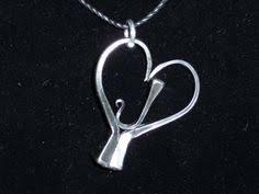 heart shaped horseshoes heart shaped horseshoe nail earrings horseshoe nails