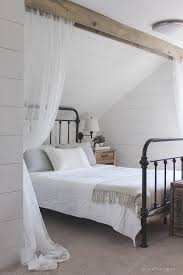 curtain over bed wood beam and lace curtains love grows wild