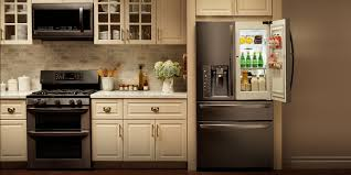 white kitchen cabinets and black stainless steel appliances lg black stainless steel series black stainless steel
