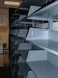 steel storage shelves file empty metal storage shelves jpg wikimedia commons