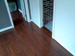 custom milled solid wood threshold color matched to laminate