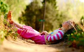 child relaxing in the garden photo and desktop wallpaper