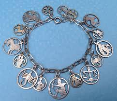 charm bracelet silver charms images Echarmony charm bracelet collection german cut out zodiac charms jpg