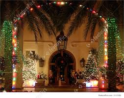 Decorate Palm Trees With Christmas Lights by Palm Framed Christmas Lit Entryway Stock Picture I1117482 At