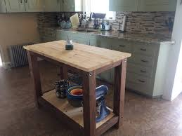 1 full shelf farmhouse kitchen island butcher block style table 1 full shelf farmhouse kitchen island butcher block style table rustic wood appearance at an affordable price