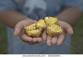 new year ornamentstack gold ingots stock photo 561822844