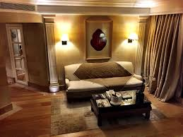 hotel room design pictures comes with solid wood couch and light