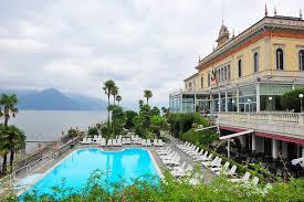 swimming pool of a grand hotel beside lake como in bellagio stock