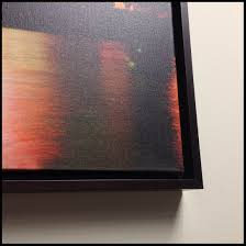 notice the subtle but effective shadow created by the gap between art and frame