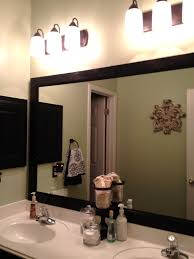 bathroom elegant decor with large framed bright metal mirrors
