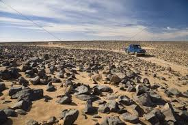 stone desert car track in stone desert akakus mountains libya sahara north a