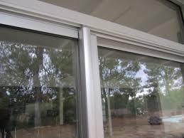 encino installation of clear anodized retractable screen door for