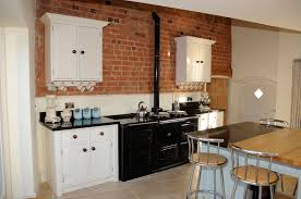 white wooden kitchen cabinet on brown brick wall connected by