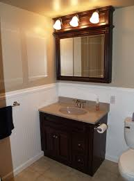 dazzling small bathroom design featuring toilet and bath vanity