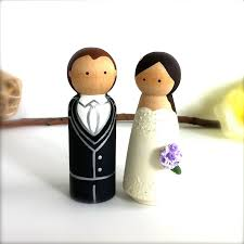 custom wedding cake toppers and groom cake toppers custom wedding cake topper peg doll cake topper